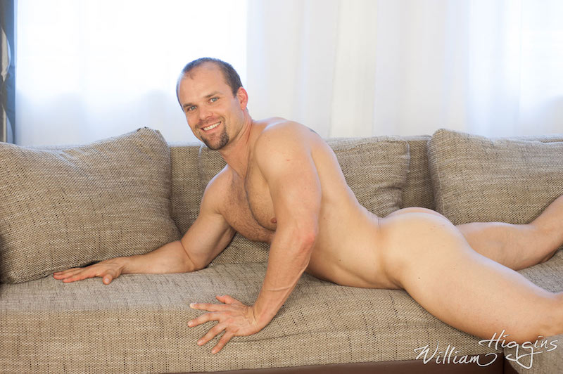 smiling naked daddy laying on a couch