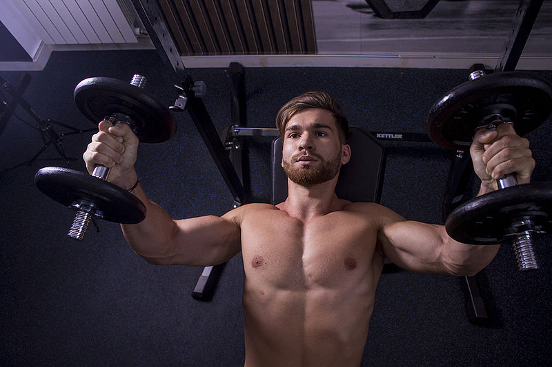 handsome jock working out shirtless