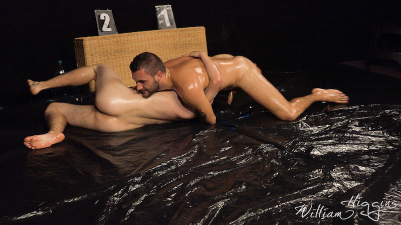 two naked men wrestling in oil