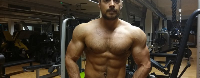 hairy muscle man at the gym