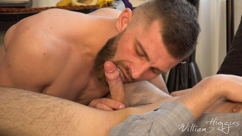 bearded man sucking a twink cock