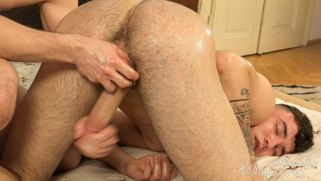 Straight boy Simon enjoys the feel of his cock and balls being massaged by another guy for the first time