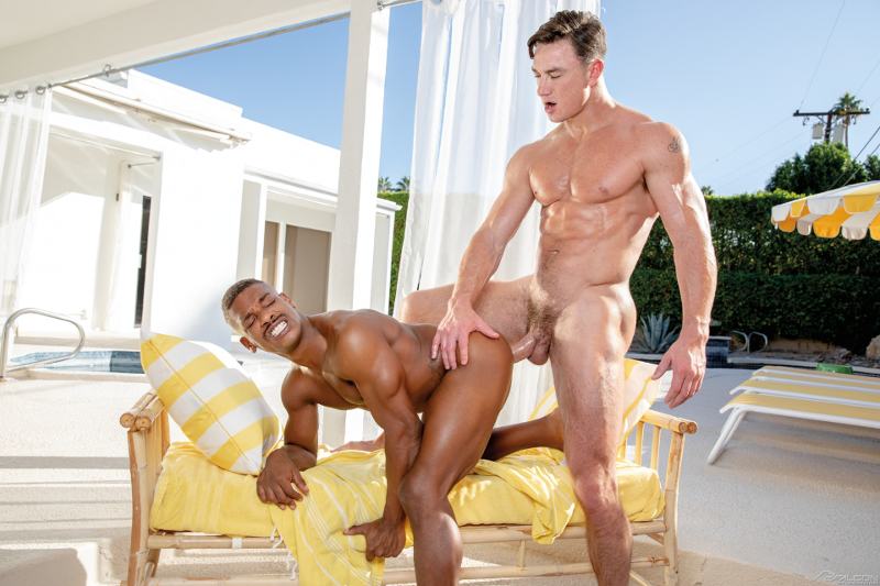 Cade Maddox fucks Adrian Hart from behind with his big bareback muscle cock