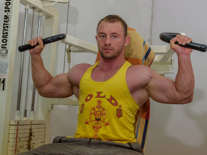 Muscle man Chris Rocks working out