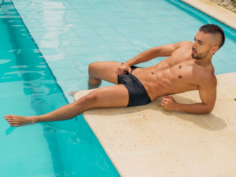 Liam Wells poolside on gay cams